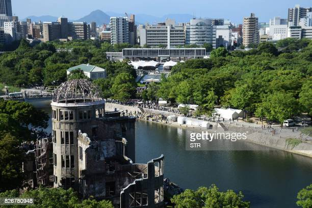 This overhead view shows the Hiroshima Atomic Bomb dome and Peace Memorial Park as people attend the 72nd anniversary memorial service for the atomic...