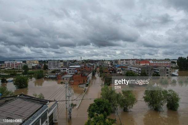 This overhead view taken on August 12, 2021 shows flooded streets following heavy rains in Suizhou in China's central Hubei province. - - China OUT /...