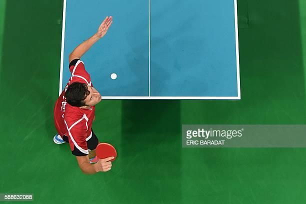 This overview shows Belarus' Vladimir Samsonov serving against Japan's Jun Mizutani in their men's singles bronze medal table tennis match at the...