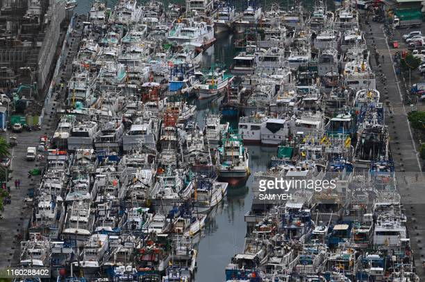 TOPSHOT This overview shows fishing boats packed into the typhoon shelter at Nanfangao harbour in Suao Yilan county as Typhoon Lekima approaches off...