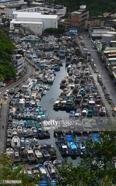 This overview shows fishing boats packed into the typhoon shelter at Nanfangao harbour in Suao Yilan county as Typhoon Lekima approaches off the...