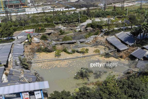 This overview shows the accident site after a road collapse in Foshan in China's southern Guangdong province on February 8 2018 Eight people died and...