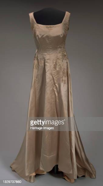 This pale bronze gown was designed by costumier Barbara Karinska and worn by Marion Anderson, then later altered and worn by Denyce Graves. The gown...
