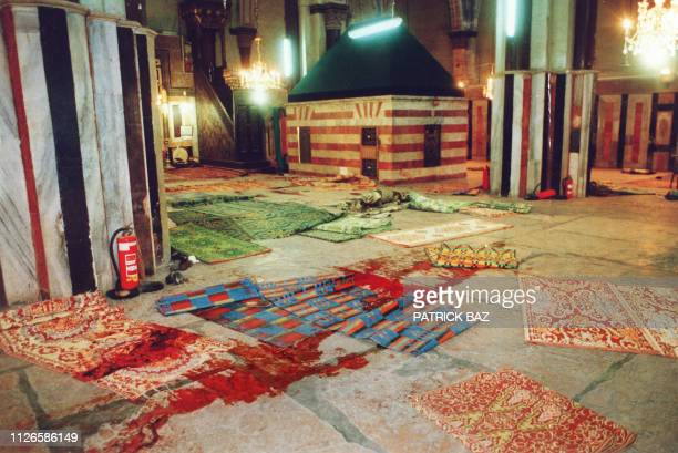 This partial view of the Hebron mosque dated 25 February 1994 shows praying carpets covered with blood in the aftermath of the Cave of the Patriarchs...