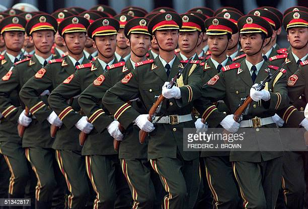 This photo dated 13 September 2001 shows People's Liberation Army soldiers marching en masse during a ceremony in Beijing China announced 25...