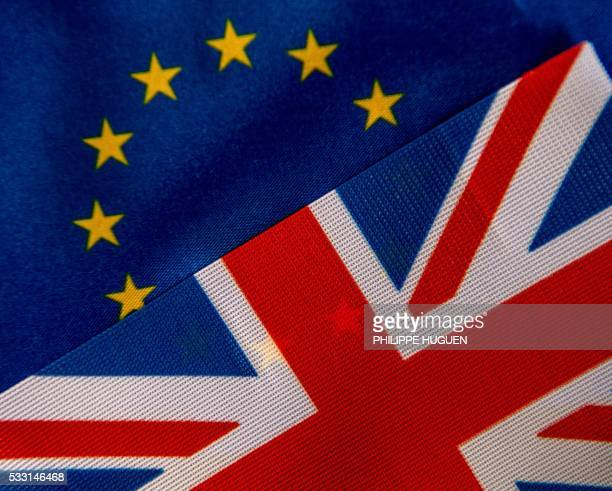 This photo illustration created on May 20 2016 in Lille shows the flags of the European Union and the United Kingdom On June 23 2016 Great Britain...