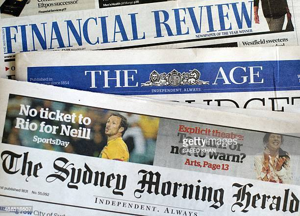 This photo illustration show newspaper front pages of media group Fairfax in Sydney on May 7 2014 Struggling Australian newspaper group Fairfax...