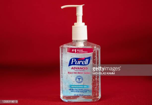 This photo illustration shows a bottle of hand sanitizer on March 5, 2020 in Washington,DC. - Amazon pledged on March 5, 2020 to take steps to fight...