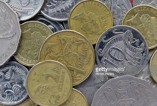 This photo illustration shows a mixture of different value Australian coins in Sydney on June 5 2014 Australians lose more than 100 million USD worth...
