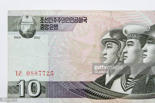 This photo illustration shows a North Korean 10 won currency bank note issued by Pyongyang and displayed in Seoul on January 4 2018 At official...