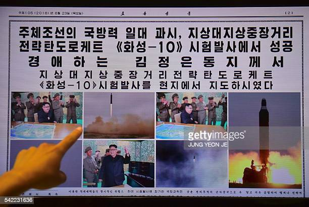 This photo illustration shows a person in Seoul on June 23 2016 pointing to a computer screen page of the North Korean newspaper Rodong Sinmun...