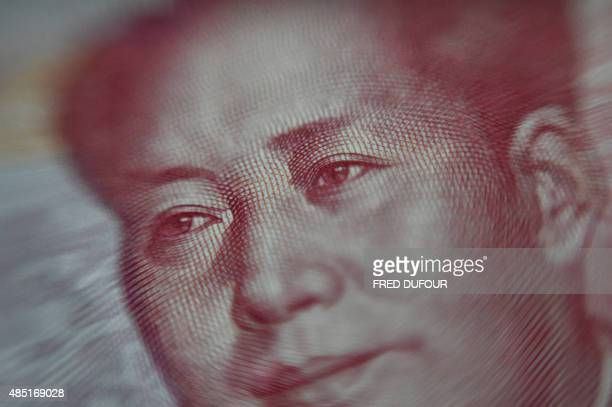 This photo illustration shows a portrait of former Chinese leader Mao Zedong on a Chinese 100yuan note in Beijing on August 25 2015 China's central...
