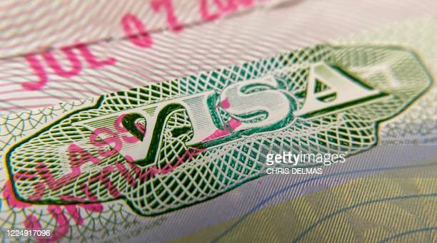 This photo illustration shows a visa stamp on a foreign passport in Los Angeles on June 6 2020 The United States said July 6 it would not allow...