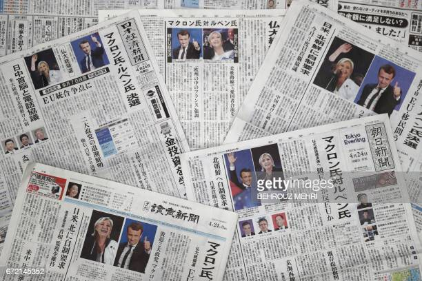 This photo illustration shows front pages of Japanese newspapers in Tokyo on April 24 reporting on results of the first round of France's...