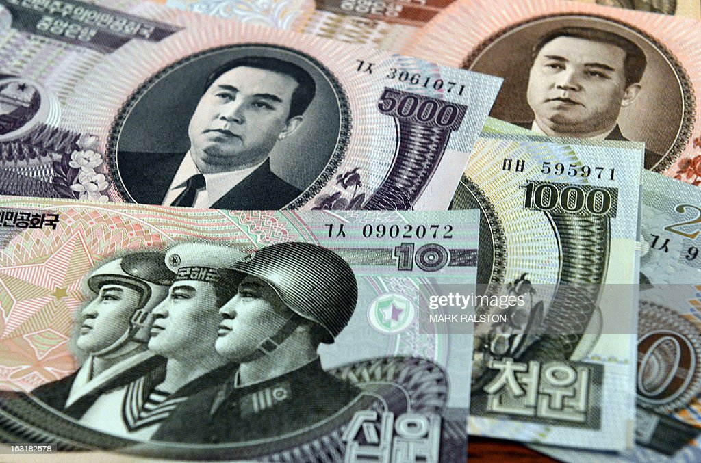 This photo illustration shows North Korean currency purchased at a Chinese border town, in Beijing on March 6, 2013. The United States and China called on the UN Security Council to sanction North Korean diplomats and 'illicit' cash transfers to step up pressure on Pyongyang's nuclear program. AFP PHOTO/Mark RALSTON