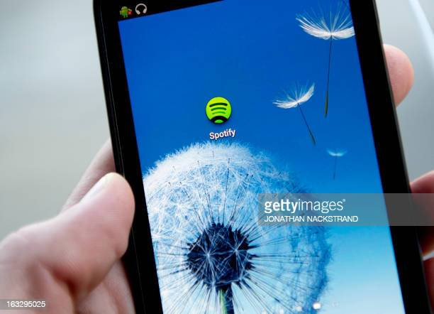 This photo illustration shows the Android application logo of Swedish music streaming service Spotify on March 7 2013 in Stockholm Sweden Sweden is...