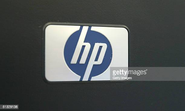 This photo illustration shows the Hewlett Packard logo The electronics giant bought back approximately $13 billion in stock from Merrill Lynch...