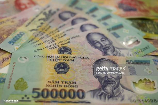 This photo illustration shows the highest denomination Vietnamese dong banknotes in Hanoi on May 21,2019.
