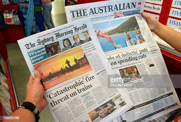 This photo illustration shows the new tabloid sized version of The Sydney Morning Herald and The Australian braodsheet paper in Sydney on March 4...