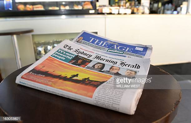 This photo illustration shows the new tabloid sized version of the The Sydney Morning Herald and The Age displayed at a cafe in Sydney on March 4...