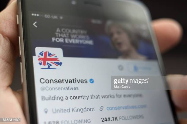 This photo illustration shows the Twitter page for the Conservative Party on an iPhone on April 26 2017 in Bristol England The use of digital...