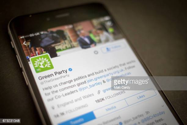 This photo illustration shows the Twitter page for the Green Party on an iPhone on April 26 2017 in Bristol England The use of digital marketing and...