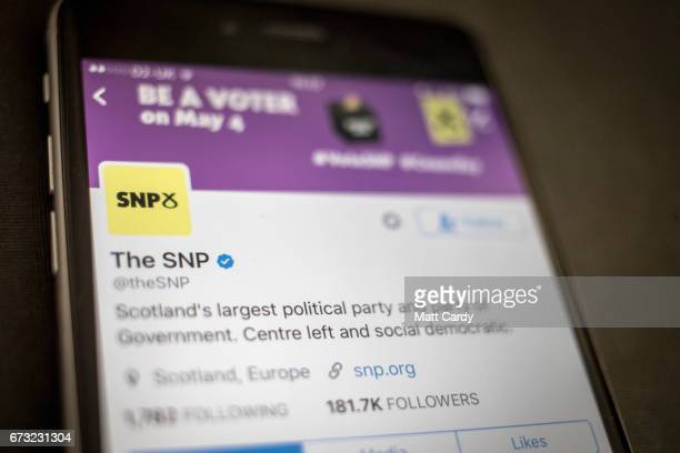This photo illustration shows the Twitter page for the SNP Party on an iPhone on April 26 2017 in Bristol England The use of digital marketing and...