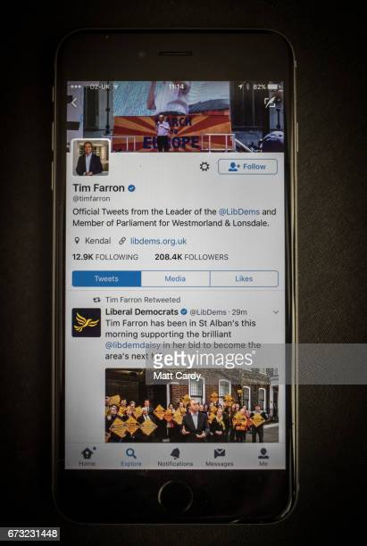 This photo illustration shows the Twitter page for Tim Farron leader of the Liberal Democrat Party on an iPhone on April 26 2017 in Bristol England...