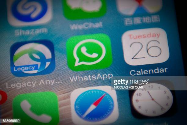 This photo illustration shows the Whatsapp application logo on a smartphone screen in Beijing on September 26 2017 Chinese authorities appear to have...