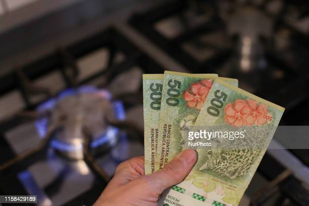 This photo illustration taken in Buenos Aires Argentina on July 28 2019 show Argentina currency New increases in the gas rate in Argentina