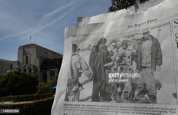 This photo illustration taken in Los Angeles shows the April 18 2012 edition of the Los Angeles Times newspaper showing a picture of US soldiers and...