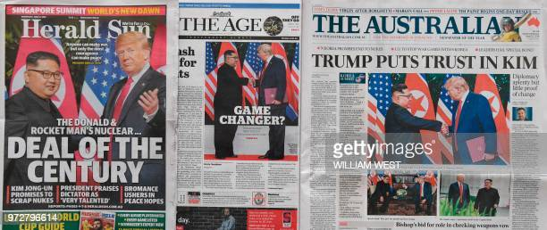 This photo illustration taken in Melbourne on June 13 2018 shows Australian morning newspapers with front page coverage of the June 12 2018 USNorth...