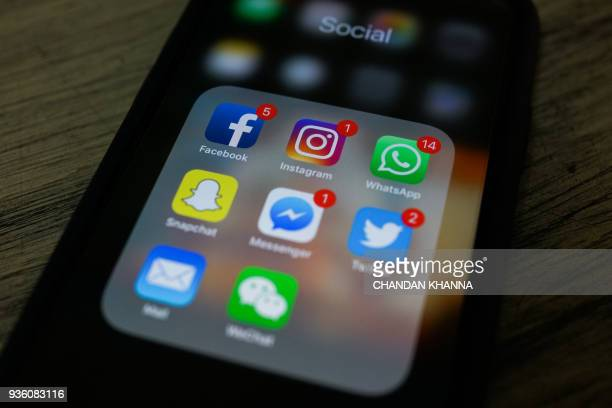 This photo illustration taken on March 22 2018 shows apps for Facebook Instagram Twitter and other social networks on a smartphone in New Delhi / AFP...