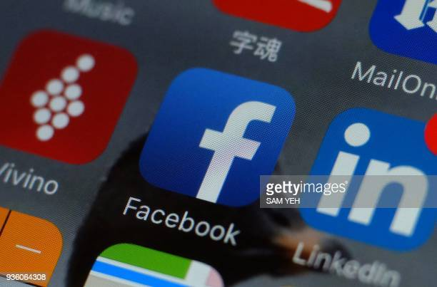 This photo illustration taken on March 22 2018 shows the Facebook logo on a smartphone in Taipei / AFP PHOTO / SAM YEH
