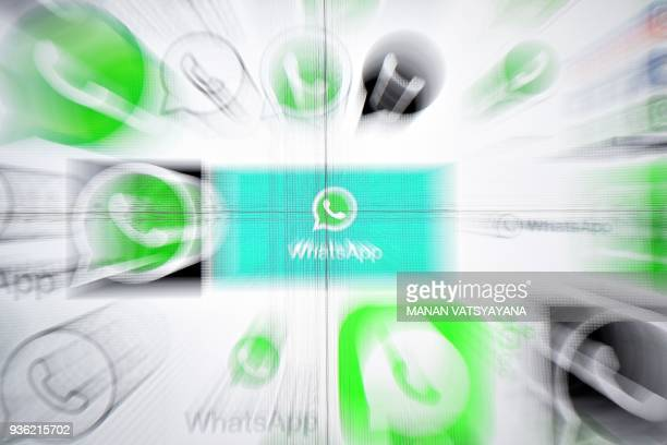 This photo illustration taken on March 222018 shows Whatsapp logos on a screen in Kuala Lumpur / AFP PHOTO / Manan VATSYAYANA