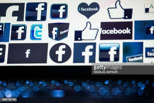 TOPSHOT This photo illustration taken on March 23 2018 shows Facebook logos on a computer screen in Beijing / AFP PHOTO / NICOLAS ASFOURI