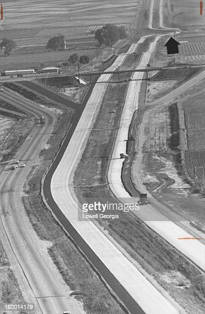 SEP 10 1962 SEP 16 1962 This photo looking south shows the twin ribbons of Interstate 25 and gives perspective to the section now under construction...