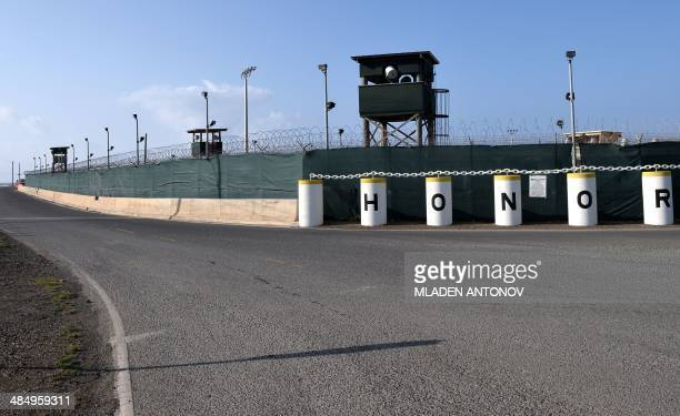 This photo made during an escorted visit and reviewed by the US military shows the razor wiretopped fence and the watch towers of Camp Delta...
