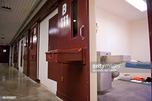 This photo made during an escorted visit and reviewed by the US military shows the corridor and the cell's doors of 'Camp 5' detention facility at...