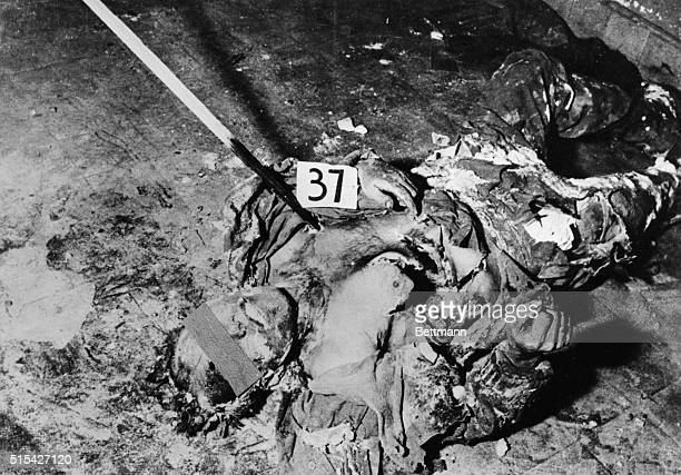 This photo obtained from Carrier Courier newspaper for the Munich Air Base shows unarmed American soldiers massacred by German SS troops at Malmedy...