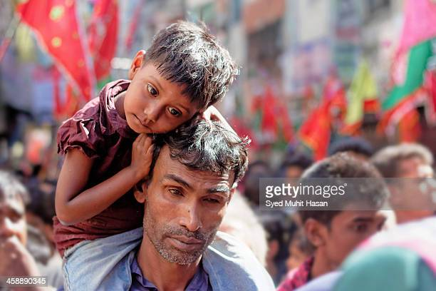 CONTENT] This photo of a father his daughter taken in old town of Dhaka This was in ashura this day is a sad day for Muslims It is commemorated by...