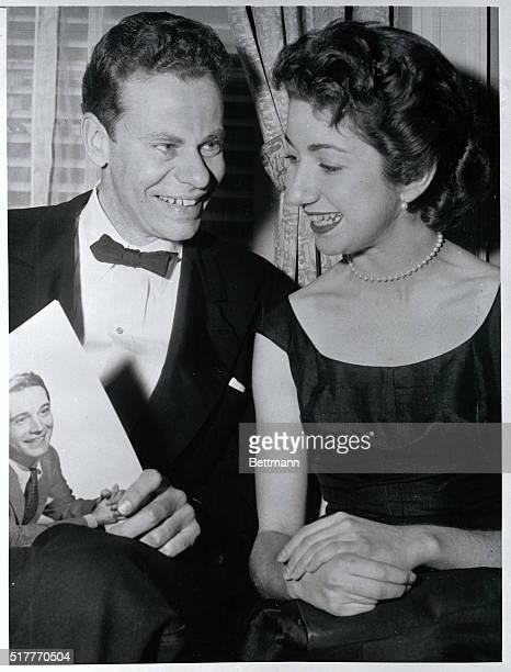 This photo of Charles Van Doren mental marvel of TV's TwentyOne and Geraldine Ann Bernstein a New York girl was made at a recent dinner in New York...