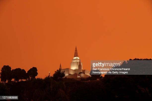 This photo of the Mormon Temple, taken with a daylight white balance, shows the effect of smoke from surrounding wildfires in the sky above Oakland,...