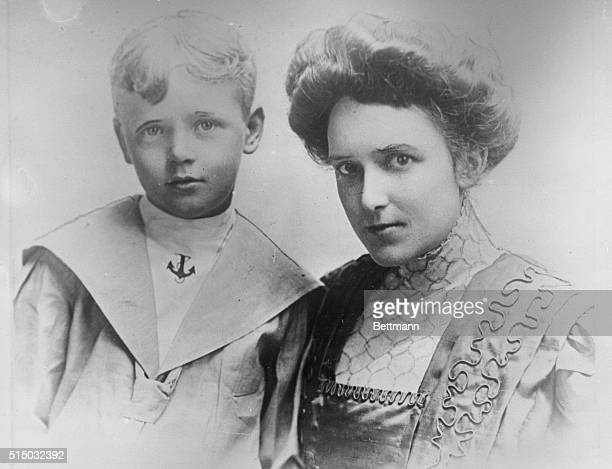 This photo, one of the early ones taken in Minneapolis, Minnesota, shows Captain Charles A. Lindbergh at the age of eight years, with his mother,...
