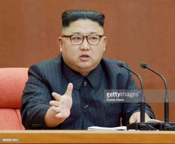 This photo printed in the Oct 8 2017 edition of the Rodong Sinmun shows North Korean leader Kim Jong Un speaking at a plenary meeting of the Central...
