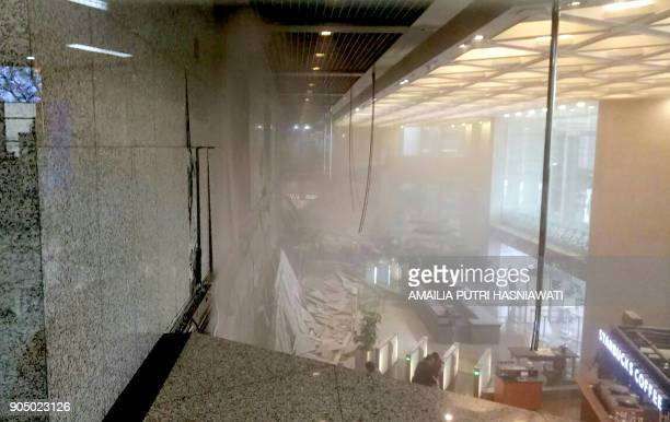 TOPSHOT This photo received from Amailia Putri Hasniawati via WhatsApp shows dust still clouding the lobby after an internal balcony collapsed at...