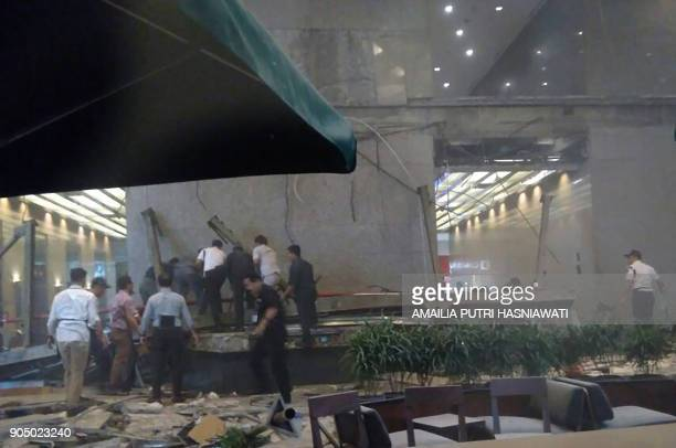 This photo received from Amailia Putri Hasniawati via WhatsApp shows people looking for victims after an internal balcony collapsed at Indonesia's...