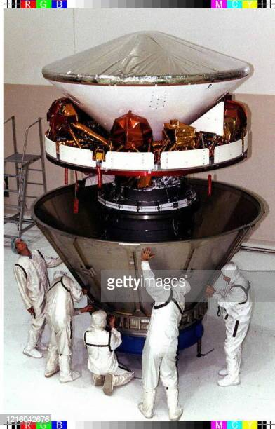 This photo released by NASA 22 November shows the Mars Pathfinder spacecraft being prepared 20 November for encapsulation by technicians at Kennedy...