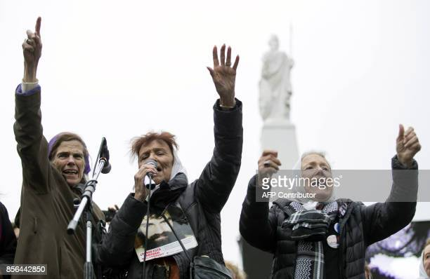 This photo released by Noticias Argentinas shows the Madres de Plaza de Mayo activists Lauda Conte Taty Almeida and Nora Cortinas shouting during a...