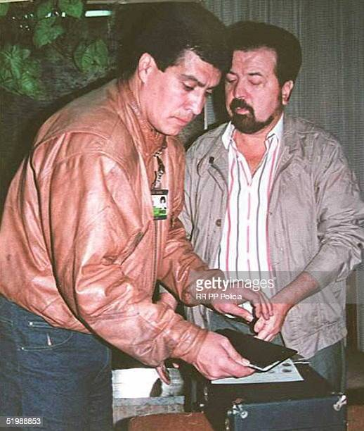 This photo released by the Colombian Police shows reputed drug lord Gliberto Rodriguez Orejuela being booked 09 June after his arrest in Cali...